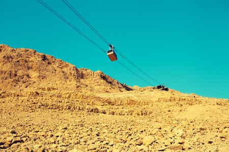 Cableway to Masada fortress, Israel. Sanrise over Judaean desert Stock Photo