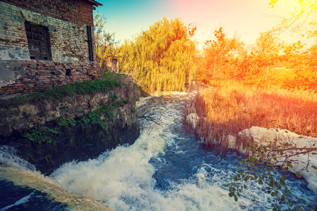 rushy: Waterfall and water mill at sunset