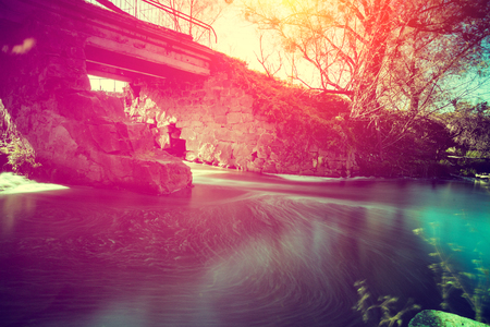 rushy: Old bridge over the river at sunset