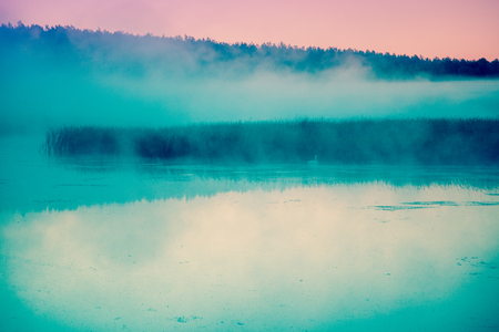 crick: Fog over the lake before dawn. Foggy morning. Rural landscape, mystical feeling Stock Photo