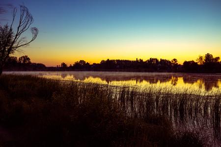 crick: Magical sunrise over the lake. Misty early morning, rural landscape, wilderness, mystical feeling