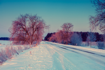 eventide: Early morning, road covered with snow at dawn