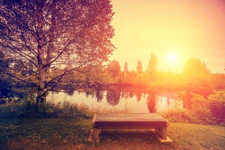 rovaniemi: Shore of the lake in autumn. The bench on the lakeshore. Beautiful idyllic autumn nature. Rovaniemi, the nature of Finland Stock Photo