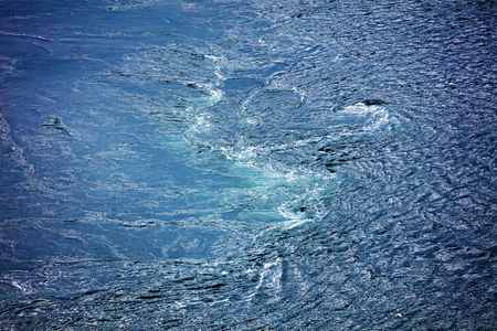 Abstract natural water background, whirlpool. Whirlpool at Saltstraumen, municipality of Bodø in Norway