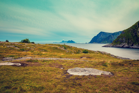 Rocky seashore with cloudy sky. Wilderness. Beautiful nature Norway. Lofoten islands Stock Photo