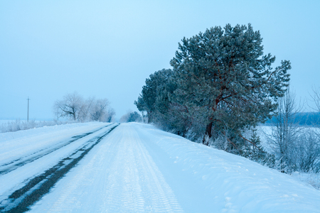 Snowy winter road in the early morning. Stock Photo