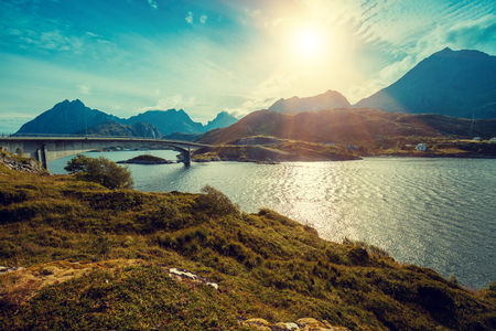 Panoramic view of the fjord with bridge at sunset light. Lofoten islands, Norway
