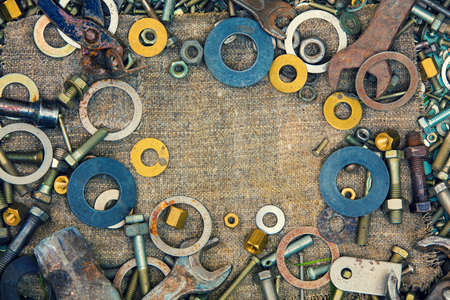 Abstract grunge metallic background from parts and tools Imagens
