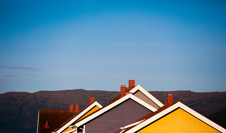metal structure: Silhouette of roofs of wooden houses. Typical architecture of Scandinavian countries. A row of wooden houses. Norway.