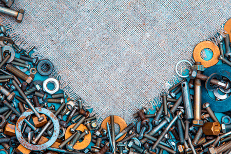 Abstract grunge metallic background from bolts, screws, nuts Stock Photo