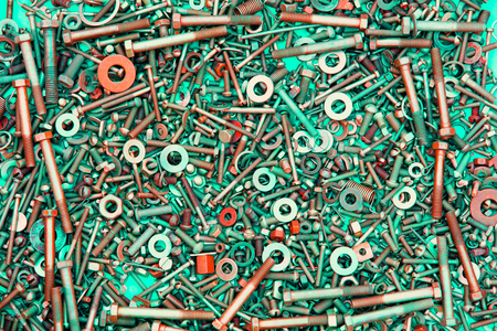 Abstract grunge metallic background from bolts, screws, nuts Imagens