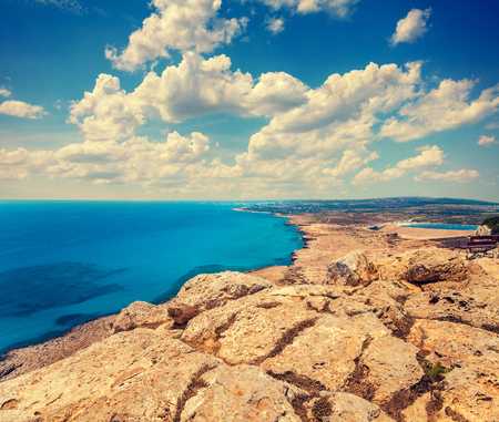 Aerial view of the open sea. Rocky seashore with blue cloudy sky. Beautiful wilderness Cyprus. Limassol