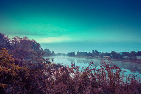 Lakeshore at sunrise. Beautiful nature in autumn Stock Photo