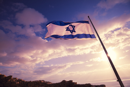 Flag of Israel on Masada against the morning sky