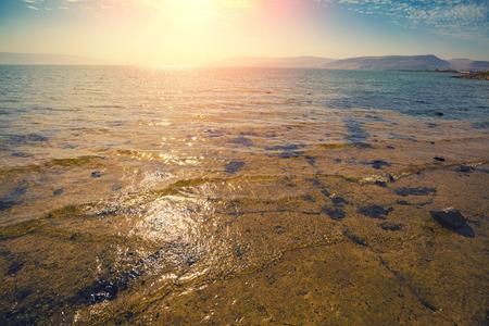 Rocky seashore. Sea of Galilee in Tabgha, Israel Stock Photo