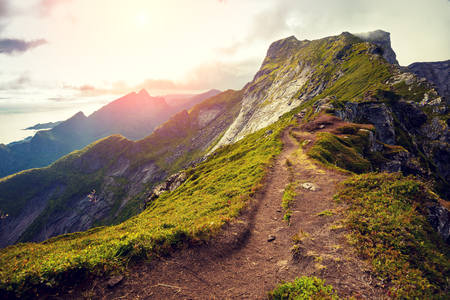 Mountain landscape with sunlight. Beautiful nature of Norway. Edge of a mountain Stock Photo
