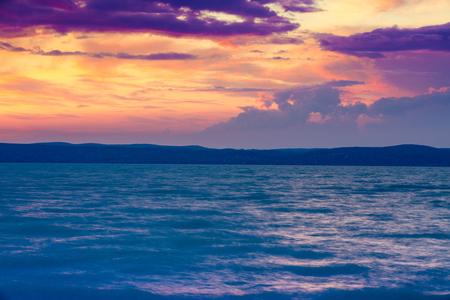Stormy rainy weather at sunset on the sea.  Balaton lake, Hungary