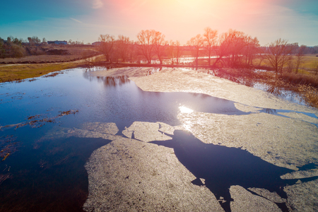 Aerial view of a river with floating ice in early spring. Rural landscape. Wild nature Imagens