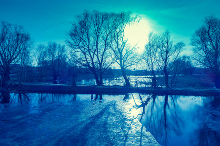 View of a river with floating ice in the evening in early spring. Rural landscape. Stok Fotoğraf