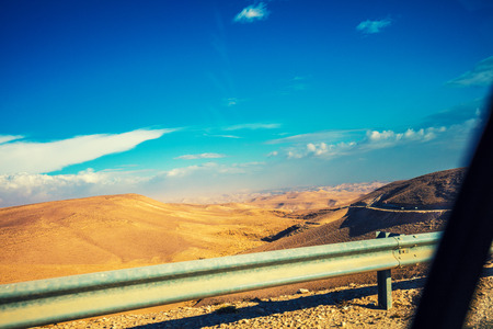 Driving a car on mountain road. View at beautiful mountain landscape from the car window. Israel