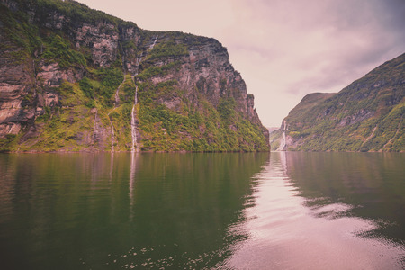 Mountain landscape with lake. Beautiful nature of Norway. Geiranger fjord. Waterfall