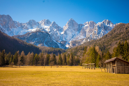 The tops of the mountains are covered with snow. Triglav national park. Slovenia, Europe Фото со стока