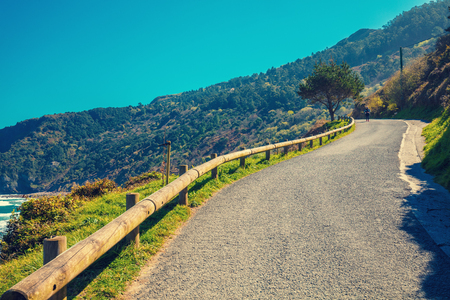 Mountain road along the sea on a sunny day Stock Photo - 124383749