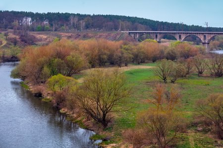 Aqueduct bridge over the river in early spring Фото со стока