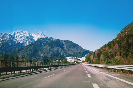 Driving a car on the autobahn between the mountains in Slovenia