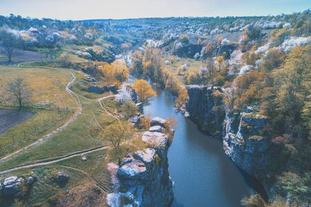 Beautiful landscape with a mountain river. The canyon in early spring. View from above Zdjęcie Seryjne