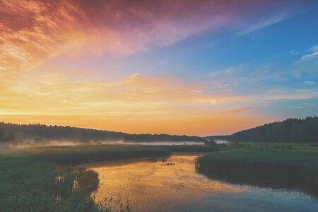 The magical sunrise over the lake. Rural landscape