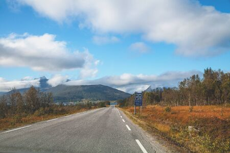 Driving a car on the road on the island of Senja, view from the windshield. Norway, Europe Zdjęcie Seryjne