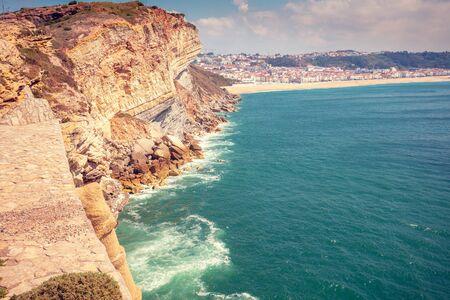 Atlantic ocean. Rocky seashore in Nazare, Portugal, Europe