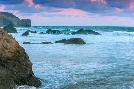 Rocky seashore before sunrise