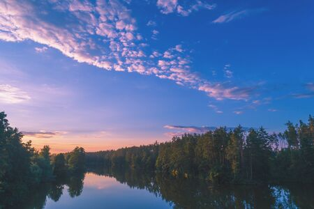 Magical sunrise over the lake in the forest. Rural landscape