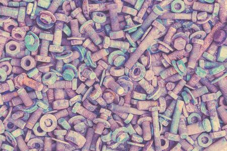 Abstract grunge metal background from old rusty bolts, screws, nuts and washers Imagens