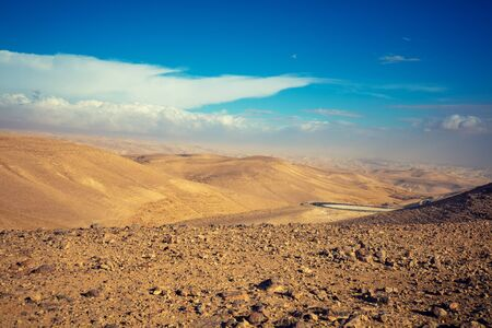 Mountain desert landscape. View of the valley from the mount. Desert in the early morning. The Judaean Desert. Landscape in Dead Sea region. Nature Israel