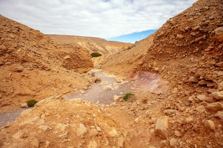 Dry riverbed. Desert nature landscape. Stone texture. Abstract natural sandstone background. Red Canyon, Eilat, Israel