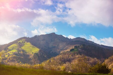 Beautiful mountains on a sunny day. View of the mountains against a blue cloudy sky. Beautiful nature landscape. Europe, Spain. Blue colored 스톡 콘텐츠