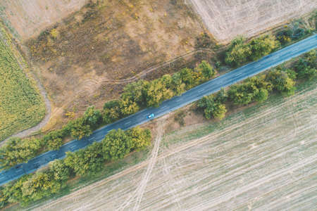 Spring rural landscape, aerial view. View of plowed fields and country road Imagens