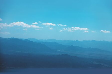 Silhouette of mountains in the early misty morning. Panorama of mountains ridge. Beautiful nature landscape
