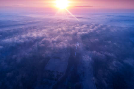 Early misty morning. Sunrise in countryside. Rural landscape in early spring. Aerial view