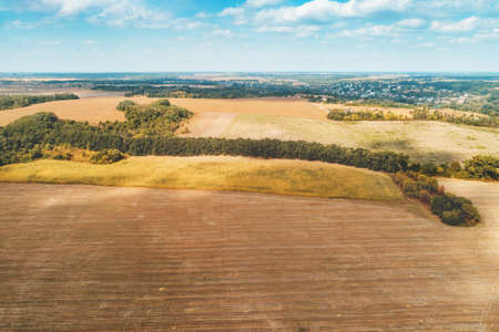 Summer rural landscape. aerial view. View of plowed fields with beautiful sky Imagens