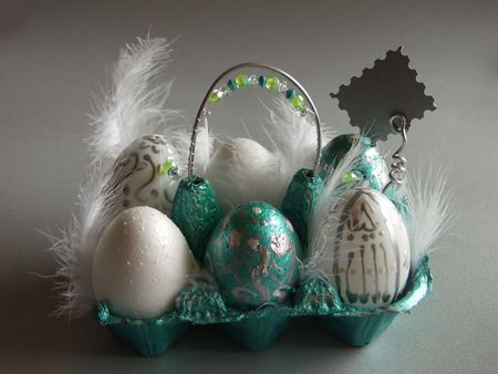 Easter basket with eggs at silver background photo