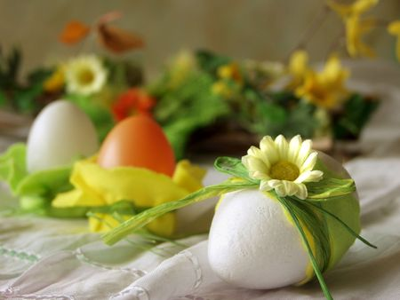 Easter table decoration, eggs and flower arrangement at background photo