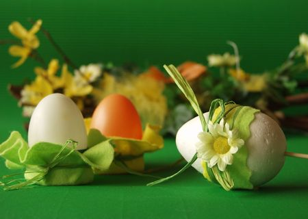 Easter eggs, flower decoration, green background photo