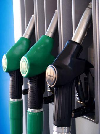 Three fuel pumps at gas station photo