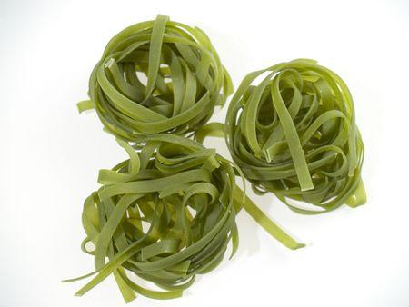 Three green pasta nests