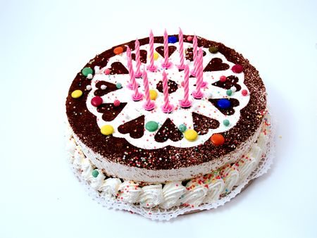 Colourful birthday cake with candles, white background