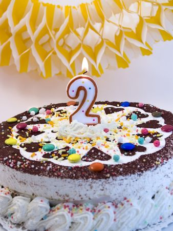 Birthday cake with number two candle